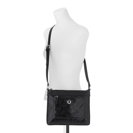 Black colored Kaos Shiny Crossbody bag
